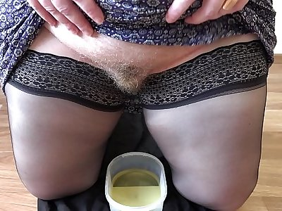 Golden shower and hairy pussy, mature milf with a fat ass records a video for a fetish friend.
